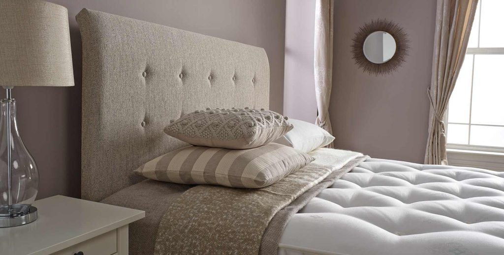 bed with decretive pillows